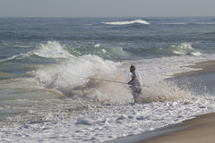 Determination (brucetopher) Tags: fishing surfcasting fish wave surf cast casting throw break breakers man fisherman sea ocean tide sport sportsman outdoor outdoors nature natural summer distance horizon beach sand wet wash overcome extreme