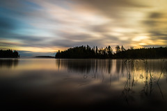 September sunrise (mabuli90) Tags: finland lake water sunrise clouds longexposure nature landscape sky forest tree grass