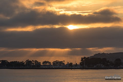 Dana Point Sunbeams (kevin-palmer) Tags: sanjuancapistrano capistranobeach orangecounty california beach pacificocean coast danapoint evening sky nikond750 nikon180mmf28 telephoto crepuscular rays sun clouds sunset gold golden sunbeams september harbor water