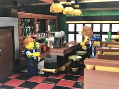 Backpacker's Inn and Irish Pub (Irish Pub Interior) (wooootles) Tags: lego moc legomoc building legobuilding architecture legoarchitecture wasabidistrict pub irishpub bar hotel legohotel hostel inn backpacker backpackersinn interior interiordesign restaurant
