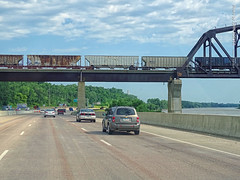 I-29, Train, and Missouri River, 12 July 2019 (photography.by.ROEVER) Tags: minnesota 2019 july july2019 vacation roadtrip 2019vacation 2019roadtrip minnesota2019roadtrip minnesota2019vacation drive driving driver driverpic ontheroad road highway iowa woodburycounty siouxcity i29 interstate29 interstate freeway southbound southboundi29 bridge rail railbridge train freighttrain river missouririver afternoon usa