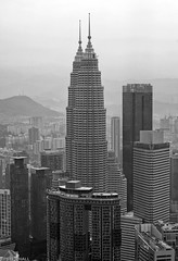KL Cityscape (peterphotographic) Tags: p8020927sefexedwm olympus em5mk2 microfourthirds mft ©peterhall kl kualalumpur malaysia seasia asia kltower twintowers petronastower petronas aerial view city cityscape urban modernarchitecture architecture building skyscraper highrise haze officeblock nik silverefexpro2 blackandwhite blackwhitephotos bw monochrome
