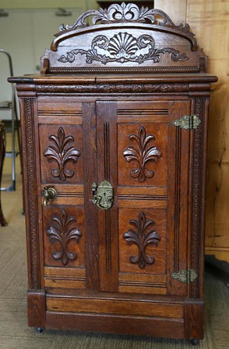 Fine Oak Ice Box with single door with spigot, back splash and heavy carving ($3,808.00)