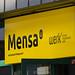 Gelber Schild von der Mensa Sportpark Müngersdorf in Köln
