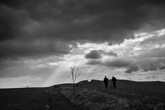epilogue... (Vladimir Barvinek) Tags: dark sky clouds weather men field murky light rays slovakia landscape monochrome blackandwhite silhouette evening