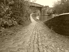 Cobbled ramp, Bottom Lock Bridge , Marple   (Peak Forest Canal)   September 2019 (dave_attrill) Tags: cobbled ramp engineerswharf bridge marple peakforest canal towpath peakdistrict nationalpark cheshire cheshirering oldknow september 2019 thomastelford sepia
