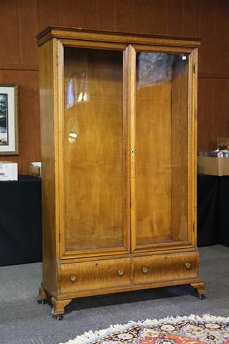 Good oak 2 door over 2 drawer bookcase ($588.00)