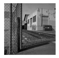 Message bollard (ADMurr) Tags: la eastside industrial tracks rolleiflex e 35 cz zeiss planar bw ilford 125 dba205