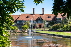 The Laboratory at RHS Wisley (Keith now in Wiltshire) Tags: wisley rhs royalhorticulturalsociety garden house building laboratory ornamental pond water lake grass lawn tree fountain halftimbered chimney wisteria