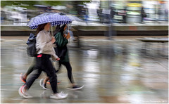 In A Hurry (Fermat 48) Tags: rain manchester stpeterssquare umbrella race water wet reflection tramstation canon eos 7dmarkii