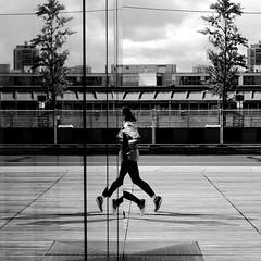 Legwork (pascalcolin1) Tags: paris13 femme woman coureur runner jambes legs legwork jeudejambes miroir mirror reflets reflection photoderue streetview urbanarte noiretblanc blackandwhite photopascalcolin 50mm canon50mm canon windows fenetres