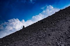 IMGP6350.jpg (alfsan) Tags: black blue rocks volcano etna sicily clouds sky pentaxart