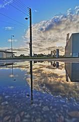 Miroir  post-apocalyptique... (Tonton Gilles) Tags: alençon normandie hdr rue laënnec nuages heure dorée lumière réverbère lampadaire câbles téléphoniques reflets flaque deau paysage urbain