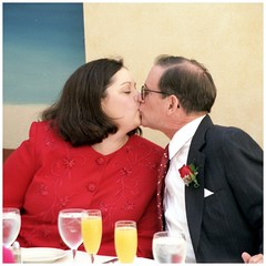Donna & Steve | Wedding Day Smooch | October 2, 1999 (steveartist) Tags: kiss smooch newlyweds couples weddingday donnasteve pastisrestaurant roswellga filmphoto october21999 table mimosas