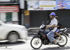 Motion capture (www.ownwayphotography.com) Tags: travel transport asia scooter man vehicle bike motorbike road motorcycle background fast people editorial thailand helmet street speed ride blur city urban asian motor rider covered person outdoor transportation water asphalt