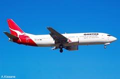 QANTAS B737 VH-TJW (Adrian.Kissane) Tags: 737 boeing airline airliner jet plane aircraft aeroplane flying flight aviation australia arriving sky outdoors 26961 1212009 vhtjw b737 melbourne qantas