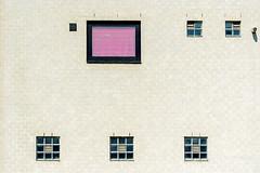 The pink window (jefvandenhoute) Tags: belgium belgië leuven wall windows pink geometric shapes