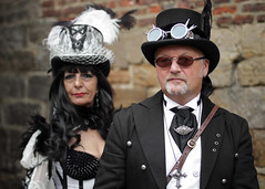 Portrait from the Whitby Steampunk Weekend VI (Gordon.A) Tags: whitby yorkshire england uk whitbysteampunkweekend wsw vi steampunk convivial festival event culture subculture style lifestyle creative costume costumes hat goggles design man lady woman people face model pose posed posing outdoor outdoors outside wall naturallight colour colours color colors amateur portrait portraiture photography digital canon eos 750d sigma sigma50100mmf18dc