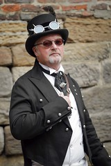 Portrait from the Whitby Steampunk Weekend VI (Gordon.A) Tags: whitby yorkshire england uk whitbysteampunkweekend wsw vi steampunk convivial festival event culture subculture style lifestyle creative costume costumes hat goggles design man people face model pose posed posing outdoor outdoors outside wall naturallight colour colours color colors amateur portrait portraiture photography digital canon eos 750d sigma sigma50100mmf18dc