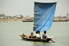 Small boat with a blue sail in Sittwe - Rakhine State - Myanmar (PascalBo) Tags: nikon d70 burma birmanie myanmar asia asie southeastasia asiedusudest sittwe akyab rakhinestate people boat bateau river rivière man homme outdoor outdoors pascalboegli