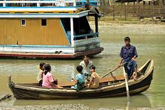 Family on a boat in Sittwe - Rakhine State - Myanmar (PascalBo) Tags: nikon d70 burma birmanie myanmar asia asie southeastasia asiedusudest sittwe akyab rakhinestate people boat bateau river rivière man homme couple woman femme outdoor outdoors pascalboegli girl fille boy garçon
