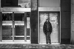 Emergency Exit (Leanne Boulton) Tags: urban street candid portrait streetphotography candidstreetphotography candidportrait streetportrait eyecontact candideyecontact streetlife sociallandscape man male face eyes expression mood emotion feeling tired smoke smoker smoking cigarette doorway exit grit grime tone texture detail depth naturallight outdoor light shade city scene human life living humanity society culture lifestyle people canon canon5dmkiii 70mm ef2470mmf28liiusm black white blackwhite bw mono blackandwhite monochrome glasgow scotland uk