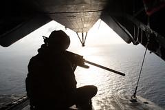 Marine sitting on the rear of a CH-53 during a flight over the ocean (MarineCorpsAviationAssociation) Tags: spmagtfsc partnership marforsouth enduringpromise ussouthcom marforres honduras