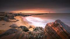Clacton Revisted (Aron Radford Photography) Tags: yellow clacton sea clactononsea essex east anglia landscape seascape beach coast costal uk dawn sunrise rocks defences pier sand