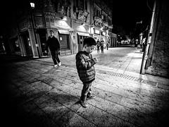 Absorbed-2.jpg (Klaus Ressmann) Tags: omd em1 boy china gulangyu klausressmann night peoplesum peoplestreet winter xiamen blackandwhite candid flcpeop streetphotography unposed omdem1