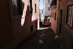 /*\ (*F~) Tags: lisboa portugal light obscurity tramway street yellow rose alfama walking walkers atmosphere morning morninglight explore