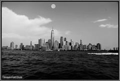 LUNA LLENA. FULL MOON. NEW YORK CITY. (ALBERTO CERVANTES PHOTOGRAPHY) Tags: fullmoon lunallena moon luna manhattan nyc usa newyork city lowermanhattan building torre tower freedomtower freedom wtc wave sky nubes clouds monachrome blancowhite superbw bw supermoon super streetphotography photography photoart photoborder art creative skyline skyscraper cityscapes landscapes indoor outdoor blur retrato portrait luz light color colores colors brillo bright brightcolors boat barcaza barge velero sailboat artisticphotography