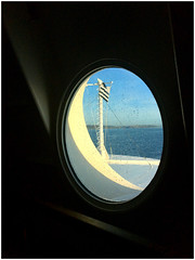 Land Ahoy (Julie (thanks for 9 million views)) Tags: smileonsaturday framed porthole window flag coast cork ireland irish sea water ferry mvpontaven ship carferry holiday breton brittany iphone6s