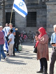 Dam Square Variety (Quetzalcoatl002) Tags: damsquare damplein amsterdam citycenter demonstration muslima israel flags conflict phone headscarf tensions activism