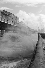 Blusterous Brighton (Henry Hemming) Tags: surf spray waterjet spume brightonpier pleasurepier stormywaters stormyseason brightonstorm bwbrighton blackandwhite roughday bwsea bwwater seaspray stormyseas moody