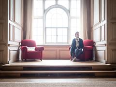 Mariëlle, Derbyshire 2019: Red chairs (mdiepraam) Tags: derbyshire 2019 sudburyhall nationaltrust interior chairs window backlight marielle portrait pretty gorgeous attractive mature fiftysomething brunette woman lady milf elegant classy scarf