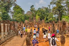 Tourist hordes trampling through Banteay Srei temple ruins near Siem Reap, Cambodia (UweBKK (α 77 on )) Tags: temple ruins angkor archaeological park stone archaeology history historic historical ancient culture cultural heritage siemreap siem reap cambodia southeast asia sony alpha 77 slt dslr tourist hordes mass tourism trample trampling tree forest jungle banteay srei banteaysrei