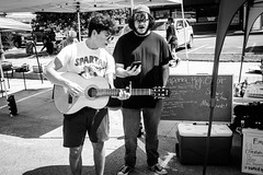X1004595 (alhawley) Tags: american americana bw usa acros blackandwhite busker busking candid everytownusa fujifilmx100f monochrome smartphonejunky street streetphotography smartphone