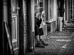READER'S DIGEST (NorbertPeter) Tags: man street people düsseldorf germany outdoor reading newspaper panasonic lumix gx8 sitting streetphotography monochrome bw blackandwhite city urban