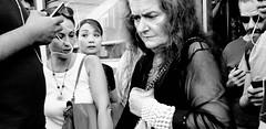 Serious business. (Baz 120) Tags: street city rome roma contrast candid strangers streetportrait streetphoto candidportrait streetcandid candidstreet life portrait people urban blackandwhite bw monochrome mono women europe noiretblanc monotone ricohgrii italy girl italia faces decisivemoment provoke grittystreetphotography