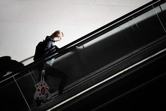 escalation (gro57074@bigpond.net.au) Tags: escalation shadows september2019 guyclift tamron 2470mmf28 d850 nikon colour color contrast lines diagonal shopping woman escalator sydneycbd wynyard street streetphotography candid
