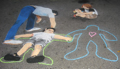 Drawing outlines (wwimble) Tags: pastels streetart viacolori 2008 shortnorth columbus ohio kids drawing outlines friends heart