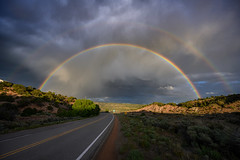 Double rainbow over the Old Las Vegas Highway near Santa Fe, New Mexico (diana_robinson) Tags: abigfave doublerainbow rainbow arc curve bandofcolor oldlasvegashighway road santafe newmexico