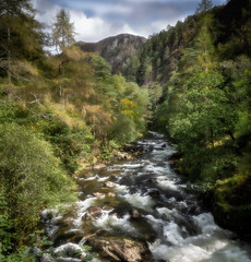 Aberglaslyn falls (paullangton) Tags: aberglaslyn falls river trees wales snowdonia valley green wild colour rapids mountain sky clouds rocks landscape outdoors nature
