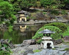 Garden lanterns (Abhay Parvate) Tags: japanese garden 庭園 旧安田庭園 kyuyasudagarden nature
