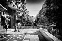 City In Grain (Alfred Grupstra) Tags: blackandwhite street people urbanscene architecture city outdoors buildingexterior traveldestinations citylife cultures cityscape builtstructure travel famousplace walking old house town thessaloniki greece