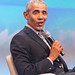 Close-up of Barack Obama with a microphone, talking at a German investors festival to connect within the startup ecosystem