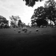 untitled (kaumpphoto) Tags: holga 120 pinhole bw black white cemetery graveyard memorial tombstone gravestone marker lawn grass garden minneapolis landscape
