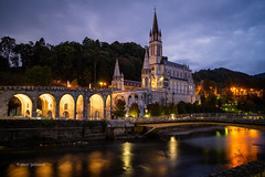 Dusk in Lourdes (pietkagab) Tags: lourdes night dusk twilight river pau water reflection sanctuary church cathedral architecture building reflections sky clouds cloudy bridge hills france french destination pilgrimage pilgrim lit lights pietkagab photography piotrgaborek sonya7 travel trip tourism sightseeing europe european town