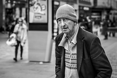 Eye Spy (Leanne Boulton) Tags: urban street candid portrait portraiture streetphotography candidstreetphotography candidportrait streetportrait eyecontact candideyecontact streetlife old man male face eyes expression mood emotion feeling beanie hat cardigan autumn fall cold tone texture detail depthoffield bokeh naturallight outdoor light shade city scene human life living humanity society culture lifestyle people canon canon5dmkiii 70mm ef2470mmf28liiusm black white blackwhite bw mono blackandwhite monochrome glasgow scotland uk