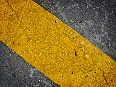 Yellow streak (Steve Brewer Photos) Tags: france lepuyenvelay yellow bright line diagonal texture surface contrast road roadmarkings